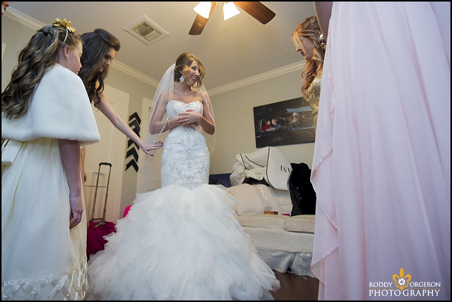 bride puts on dress for the first time