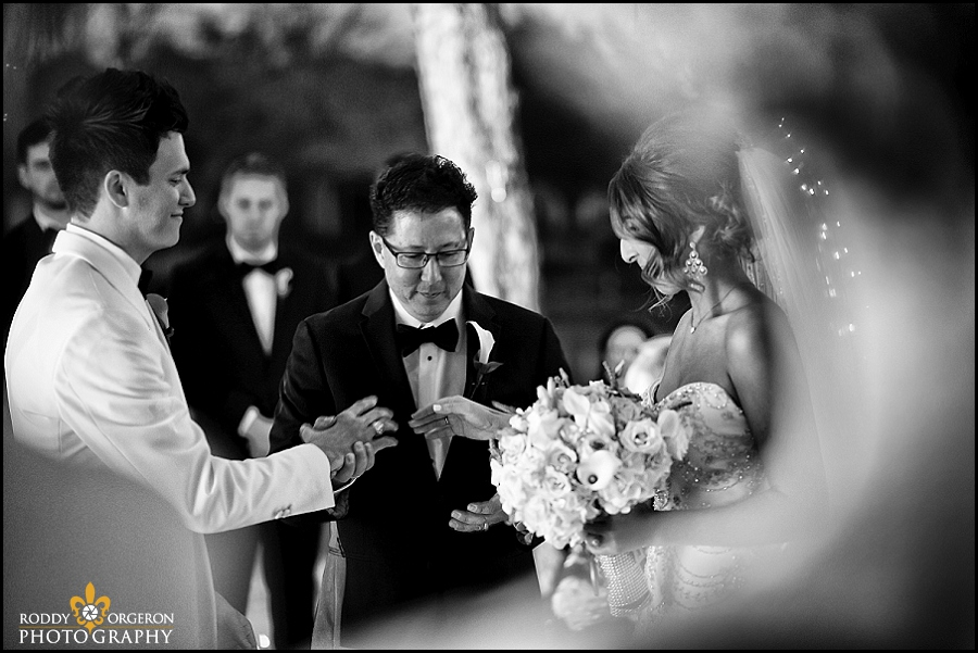 bride, groom and father pray