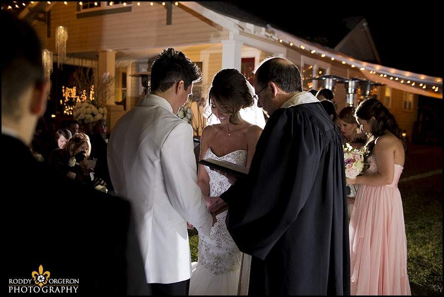 bride, groom and father pray ceremony