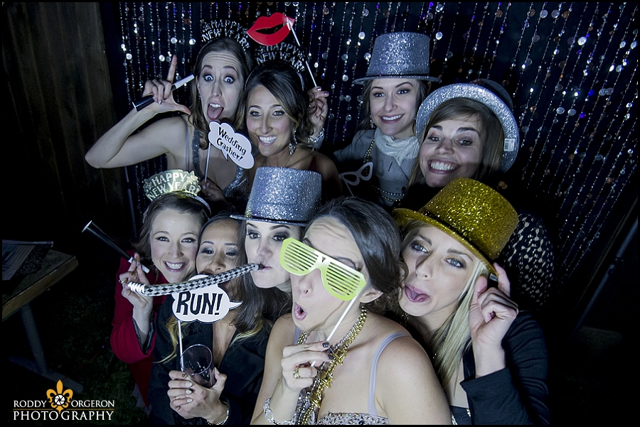 bride and friends in photobooth