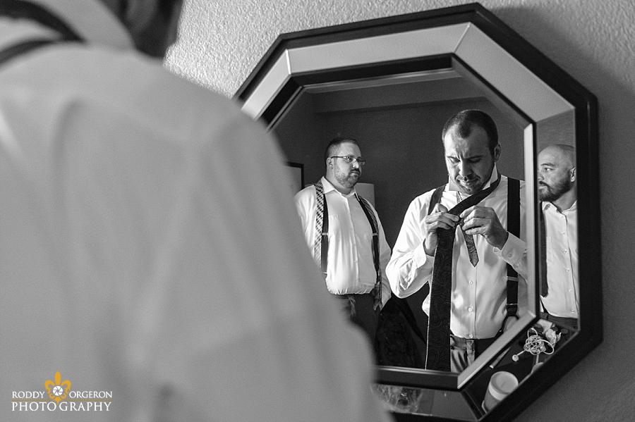groom looking in mirror getting ready
