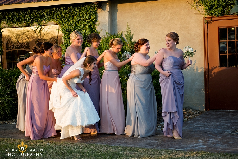 Bridemaids walking into The Olde Dobbin Station in Texas
