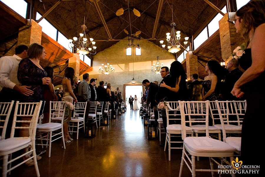 Bride walking into The Olde Dobbin Station in Texas for the ceremony