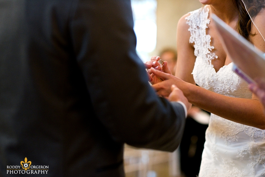 Ring exchange between bride and groom at The Olde Dobbin Station in Texas