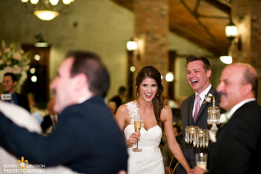 Bride and groom laughing on the dance floor The Olde Dobbin Station in Texas