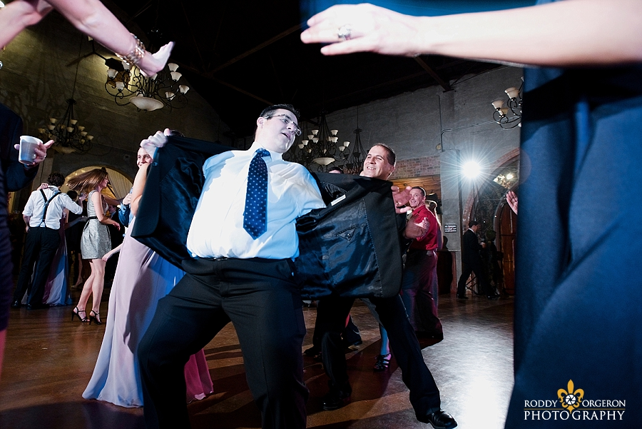 fun dancing at the wedding reception at The Olde Dobbin Station in Texas