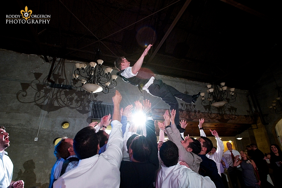 groom goes up on the dancefloor at The Olde Dobbin Station in Texas