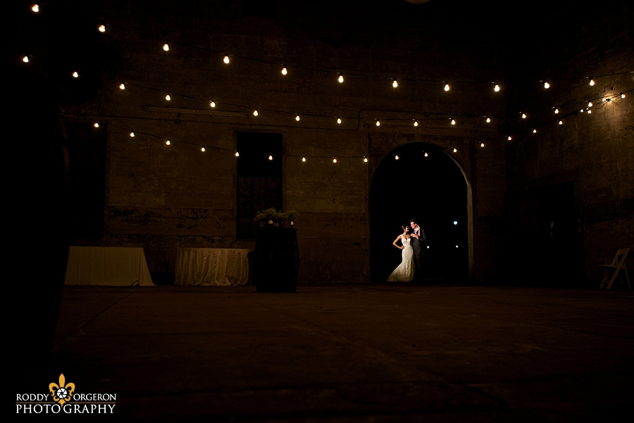 Bride and groom pose for a few minutes for some portraits at The Olde Dobbin Station in Texas