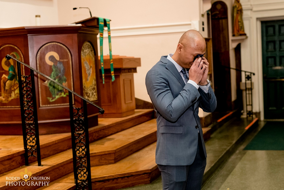 the groom cries as he sees his bride for the first time at Our Lady of Guadalupe Church in the French Quarter New Orleans
