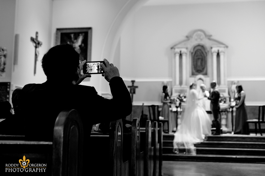 bride and groom at the alter at Our Lady of Guadalupe Church in the French Quarter New Orleans