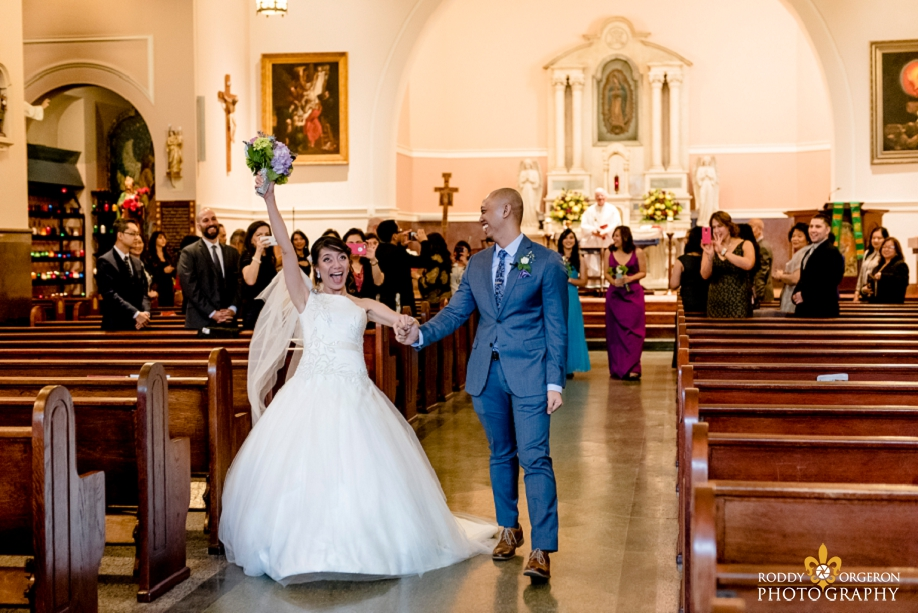 bride and groom exit the church at Our Lady of Guadalupe Church in the French Quarter New Orleans