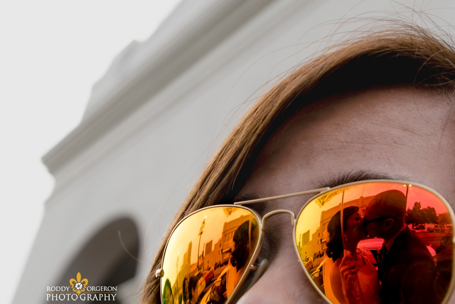 reflection of bride and groom in sunglasses at Our Lady of Guadalupe Church in the French Quarter New Orleans