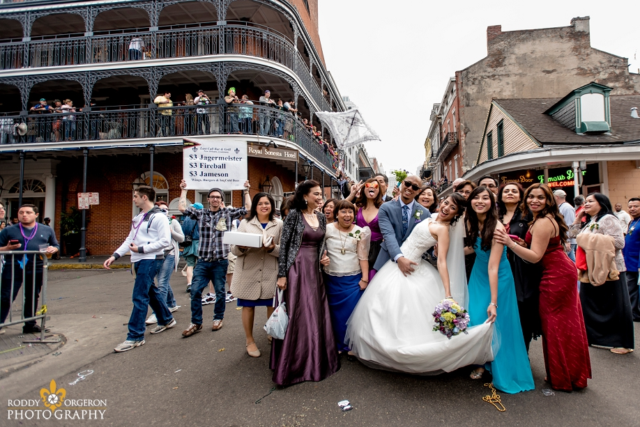bride and groom posing on Bourbon Street in the French Quarter New Orleans