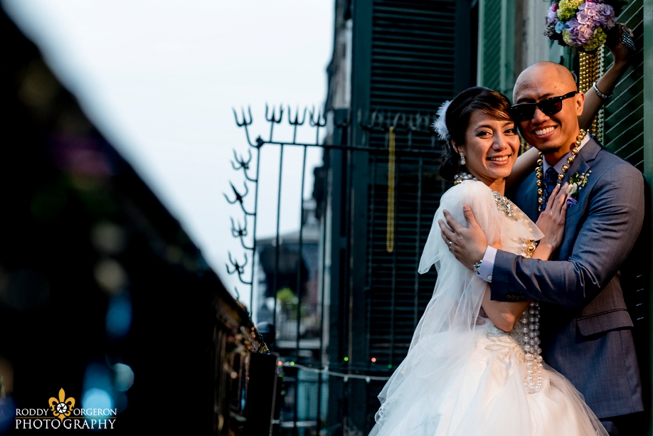 bride and groom portraits in the French Quarter New Orleans on a balcony
