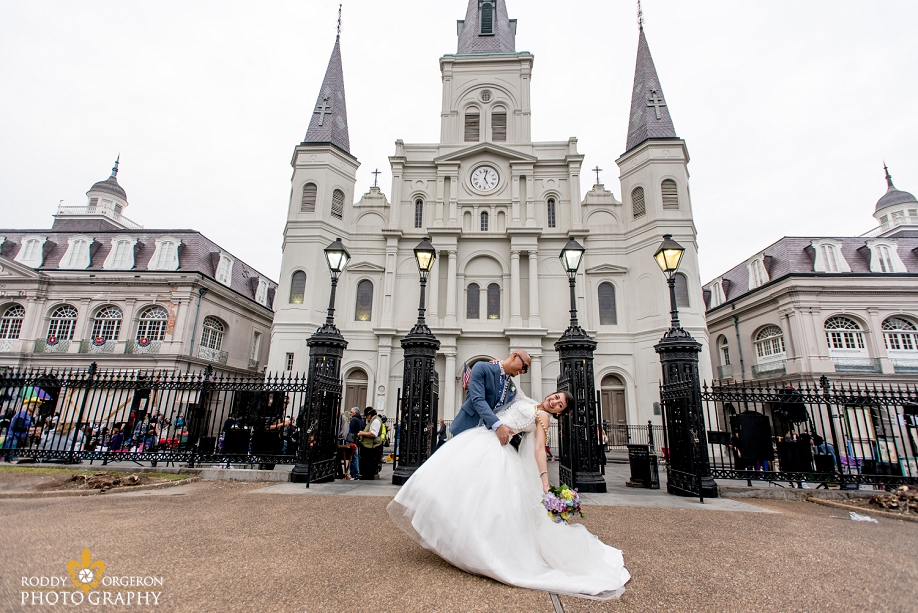 bride and groom in front of the Cathedral in the French Quarter New Orleans
