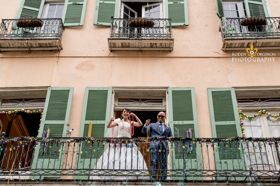 bride and groom on a balcony in the French Quarter New Orleans