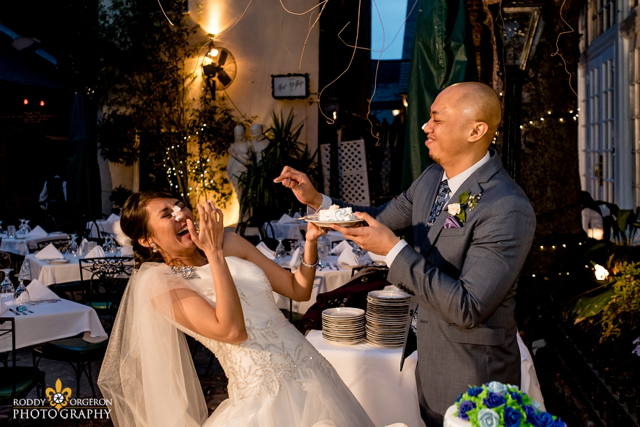 bride and groom cake smash at The Court of two Sisters in the French Quarter New Orleans