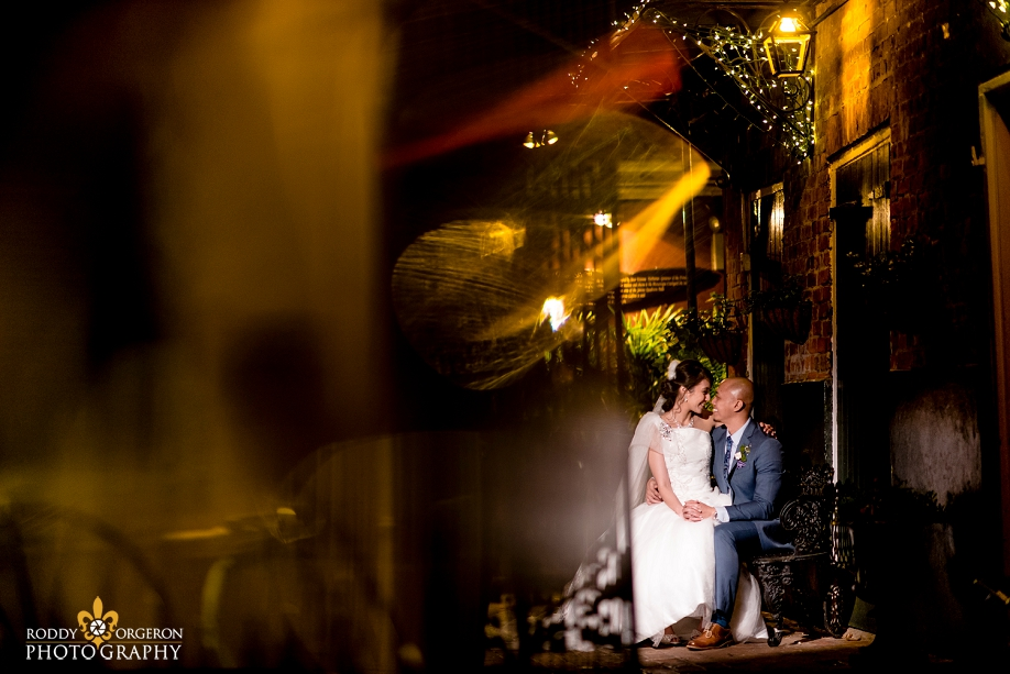 bride and groom creative portrait at The Court of two Sisters in the French Quarter New Orleans