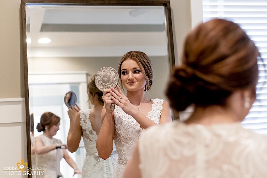 bridal prep with bride looking in the mirror