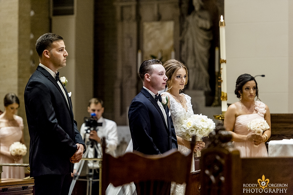 bride and groom at alter of Ursuline church in New Orleans