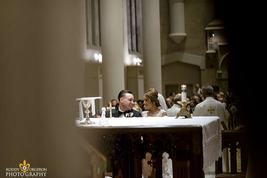 bride and groom look at each other at Ursuline church in New Orleans