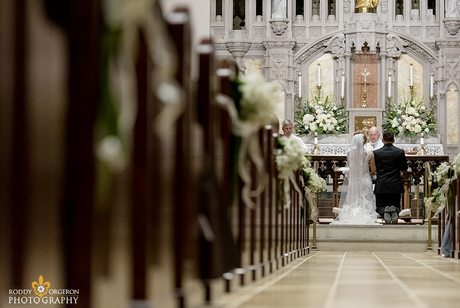 bride and groom at alter - Ursuline church in New Orleans