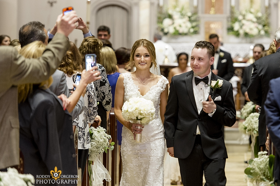 bride and groom leaving the Ursuline church in New Orleans