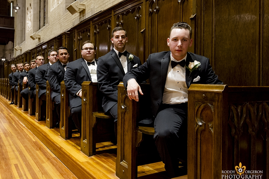 groomsmen in church waiting for ceremony to start