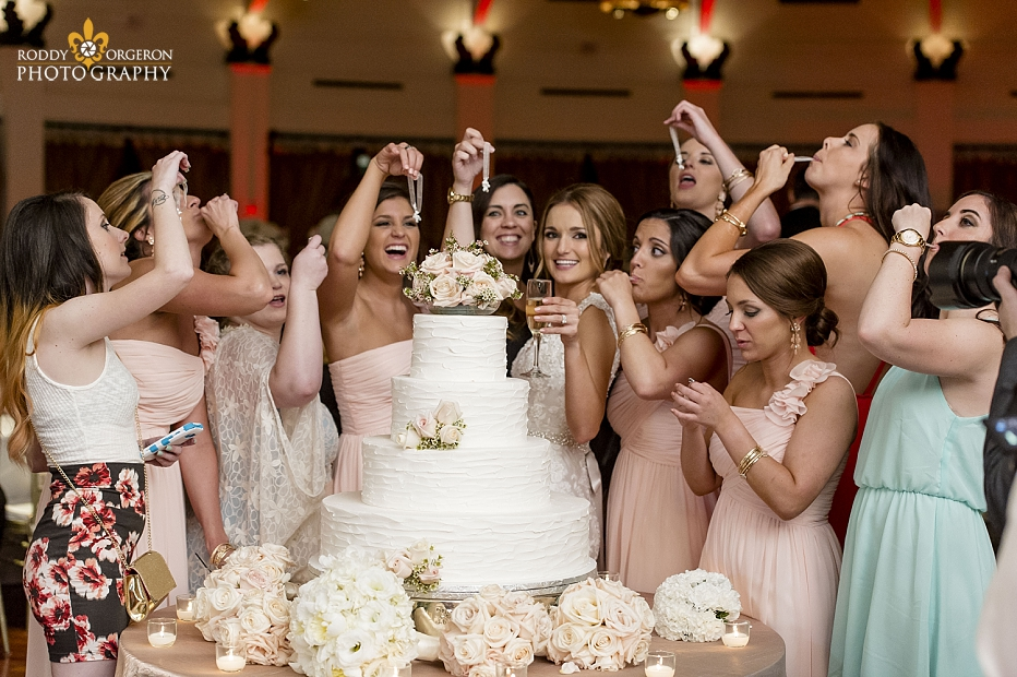 Cake pulls with bridesmaids at The Audubon Tea Room in New Orleans