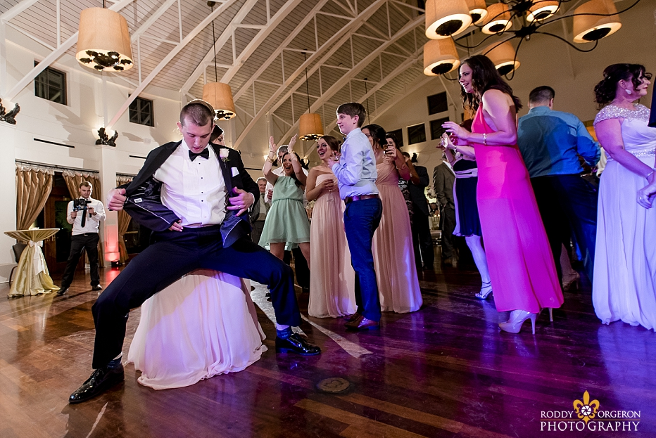 groomsmen dances on the dance floor with the bride at The Audubon Tea Room in New Orleans