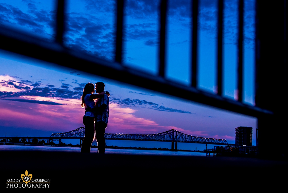 Engagement session with bridge in background