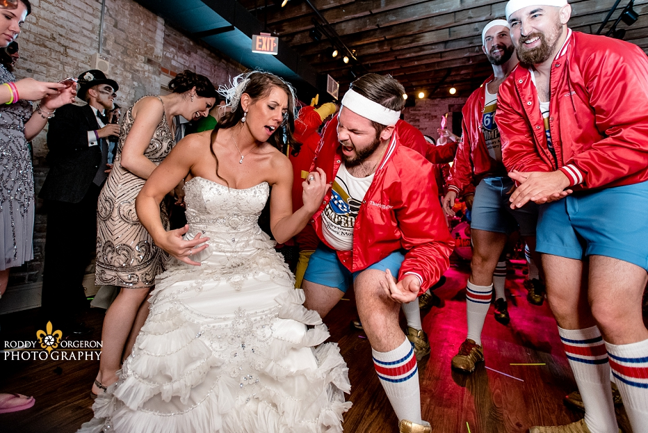 610 Stompers air guitar with bride at The Chicory
