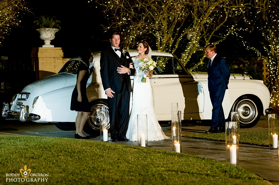 bride and her father getting out of a Rolls Royce to walk down the aisle at Southern Oaks Plantation
