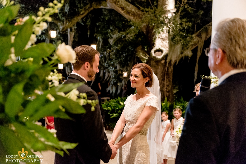 Bride and groom saying vows at Southern Oaks Plantation