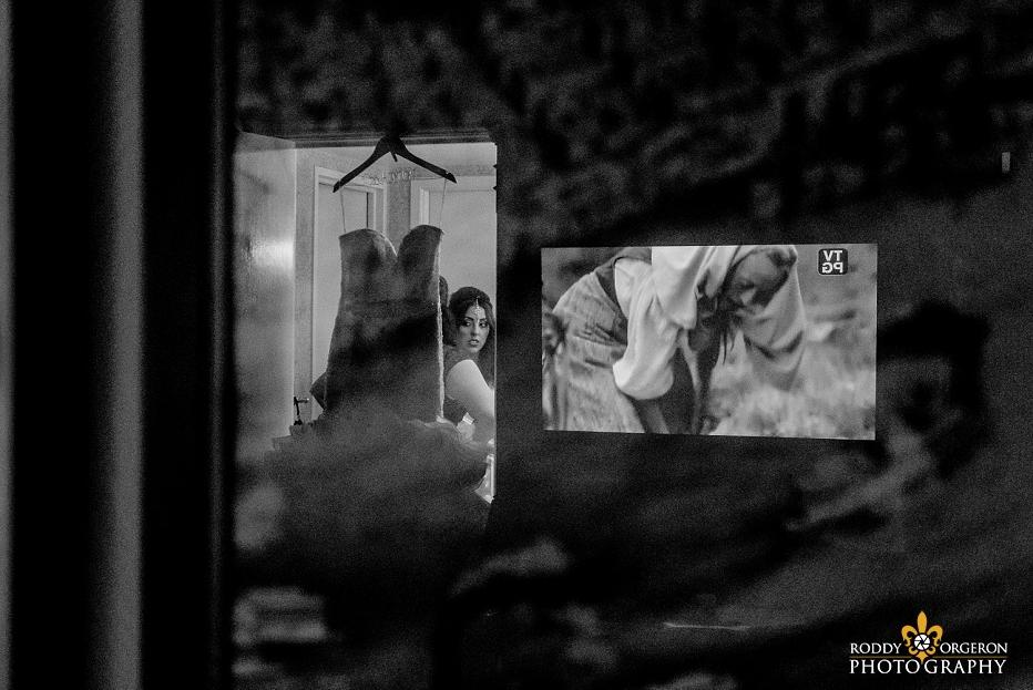 Bride looking at dress reflection