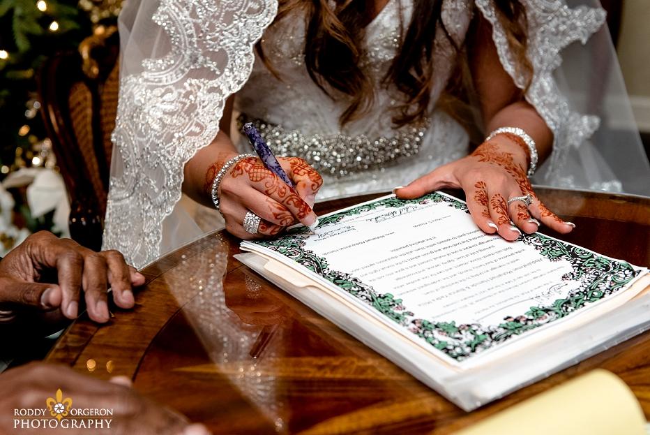 Indian wedding - bride signing marriage license