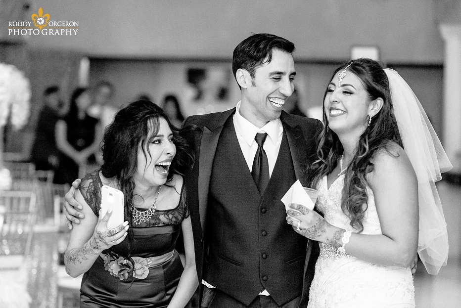 bride, groom and sister laughing