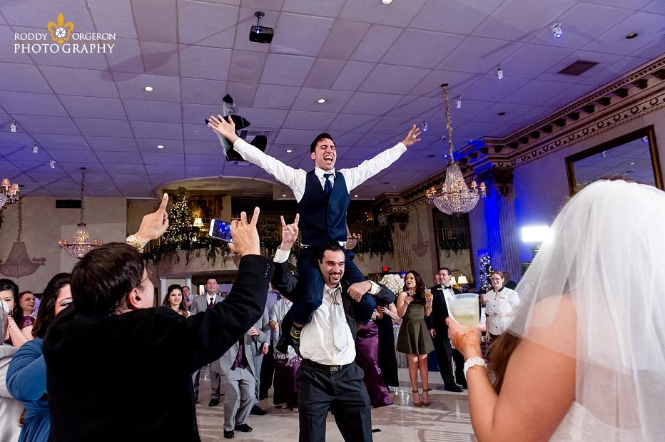 groom on shoulders celebrating