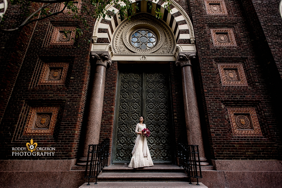 Bride standing in front of a church in her beautiful wedding dress