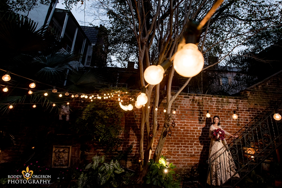 Bride in wedding dress in New Orleans in a courtyard