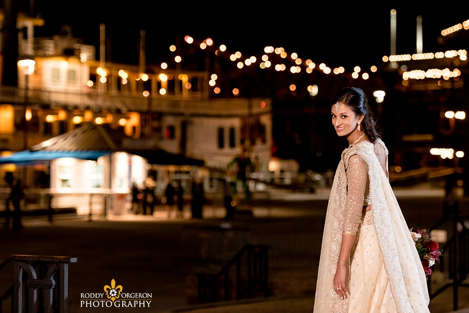 Bride in wedding dress in New Orleans by the Mississippi River