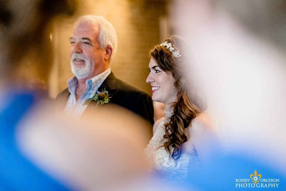 A father hands his daughter to her husband at the Chicory wedding venue