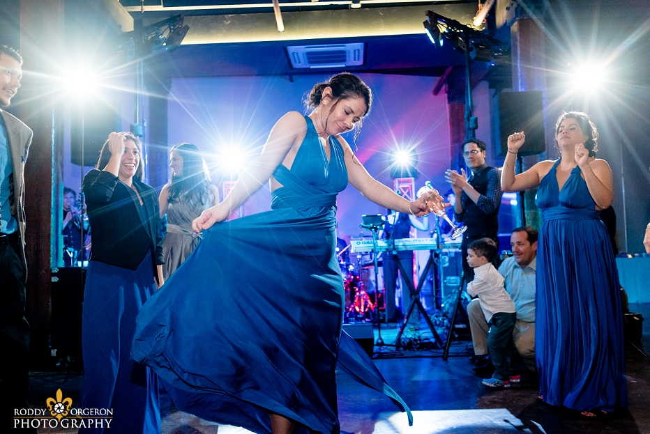 bridesmaid dancing at The Chicory wedding venue in New Orleans