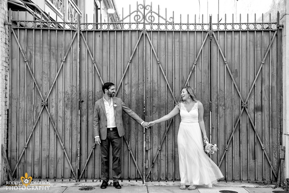Bride and groom holding hands for an engagement session in the French Quarter of New Orleans