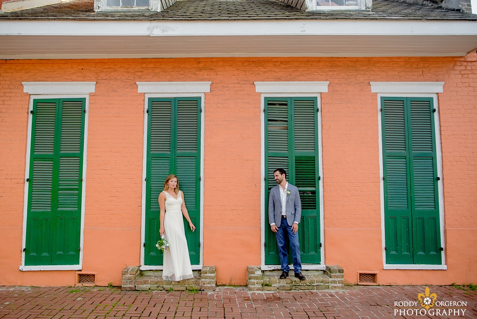 Bride and groom in front of an old New Orleans home in the French Quarter in New Orleans