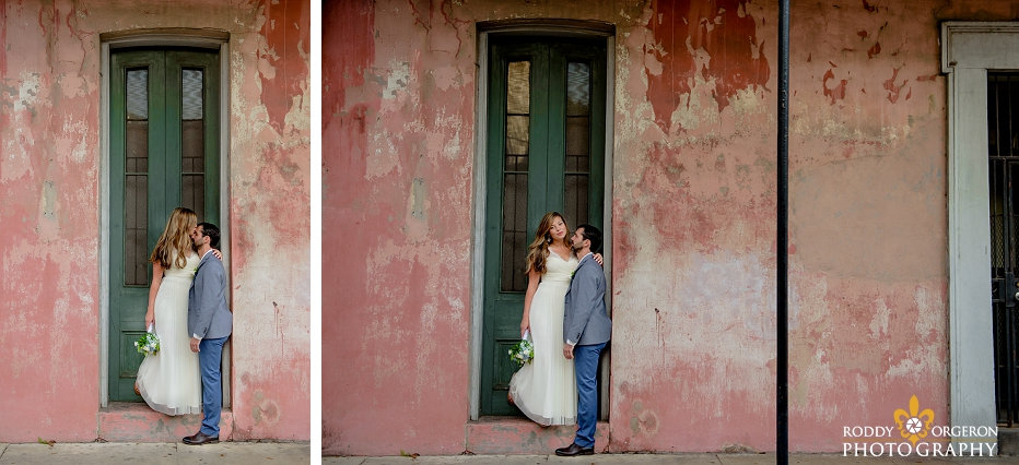 Bride and groom standing in front of an old New Orleans home in the French Quarter in New Orleans