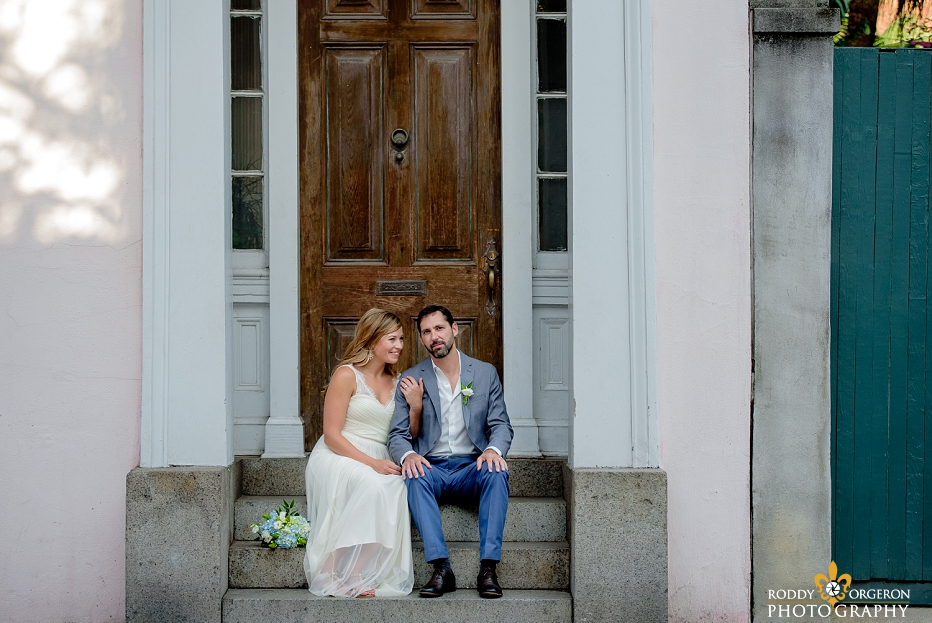 Bride and groom sitting on the steps of an old home in New Orleans