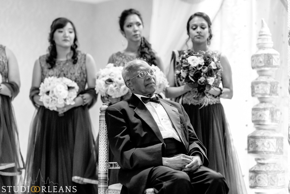 Indian wedding ceremony at the Roosevelt hotel in New Orleans - father watching bride and groom