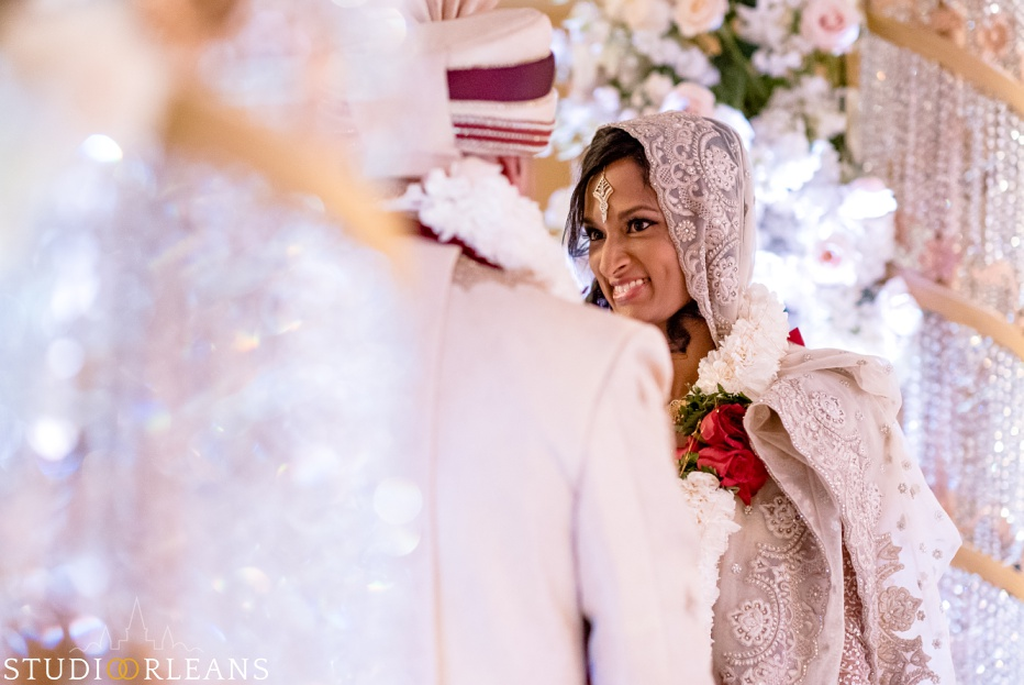 New Orleans Indian wedding ceremony at the Roosevelt hotel - bride smiling at groom