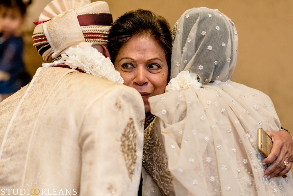 New Orleans Indian wedding ceremony at the Roosevelt hotel - mother hugging bride and groom